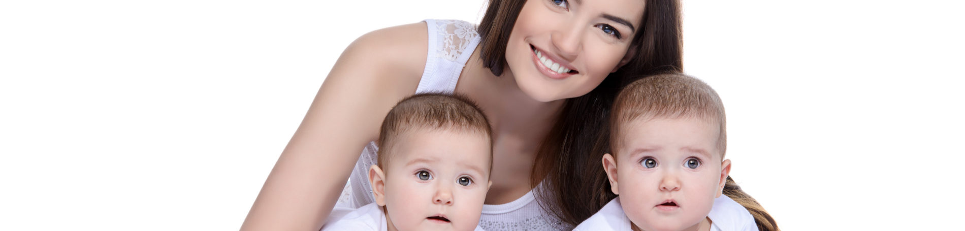 Dark haired mother smiling behind her twin babies